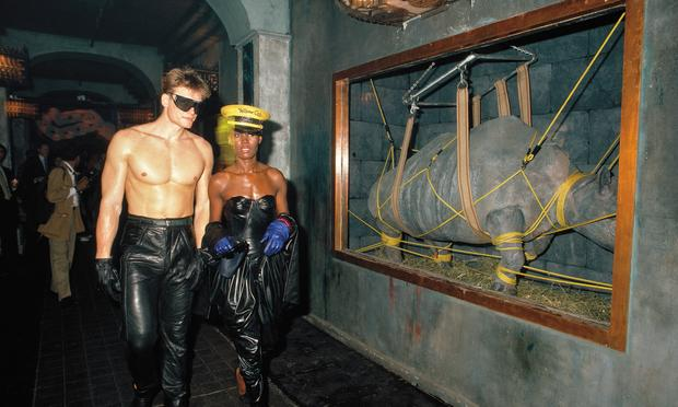 Dolph Lundgren & Grace Jones in the entrance hallway during the 'Confinement' theme.