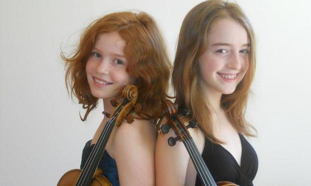 Violinists and sisters Camille and Julie Berthollet.