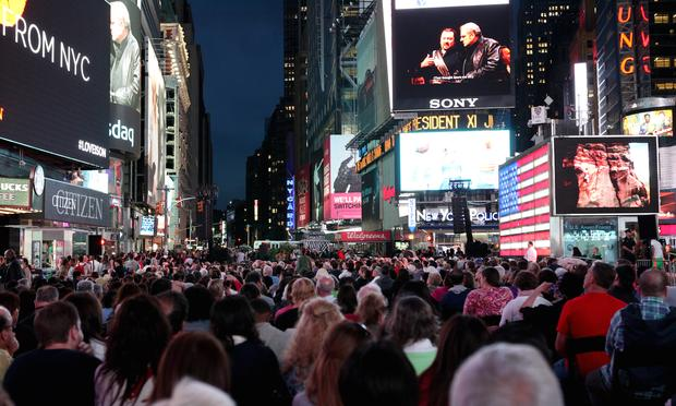 Audiences watch the opening night of the Metropolitan Opera at a live simulcast in Times Square, Sept. 21, 2015