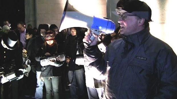 Phil Kline directs people when to hit 'play' during the 20th New York 'Unsilent Night.'