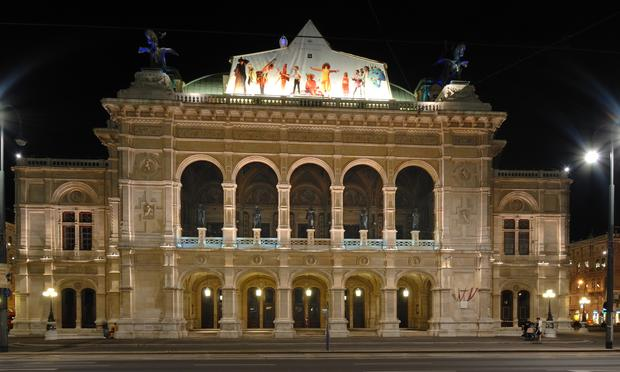 The Vienna State Opera depicted at night.