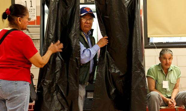 Voters in Jamaica, Queens casting ballots in the 2013 primary election.
