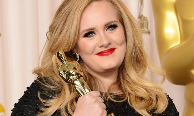 Singer Adele, winner of the Best Original Song award for 'Skyfall,' poses in the press room during the Oscars.
