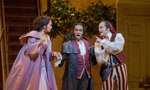 Isabel Leonard as Rosina, Lawrence Brownlee as Count Almamiva, and Christopher Maltman as Figaro, in Rossini's Il Barbiere di Siviglia.