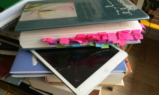 When Maria Popova, editor of Brainpickings.org, can't read a book on the iPad, she uses an elaborate system of sticky tabs and a hand written index. This is her desk. (Manoush Zomorodi/WNYC)