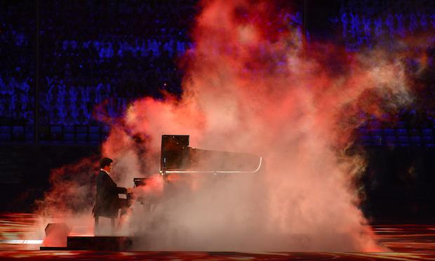 Russian pianist Denis Matsuev performs during the Closing Ceremony of the Sochi Winter Olympics on February 23, 2014