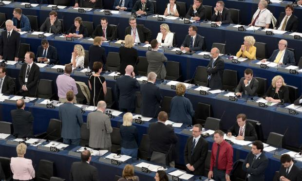 Eurosceptics members of Parliament turn their back to the assembly during the opening ceremony of the European Parliament session on July 1, 2014 in Strasbourg,
