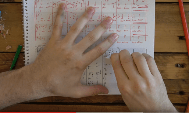 This music video for Gordon Hamilton's 'Who We Are' features hands writing the score in time with the music.