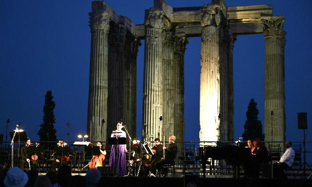Greek national opera singers perform at the archaeological site of the Olympion Zeus in Athens on July 8, 2014