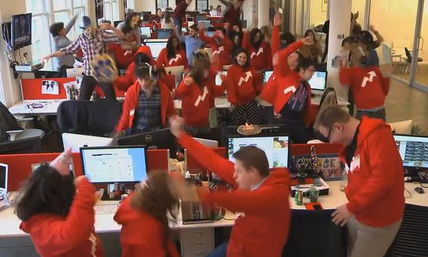 An office staff dances as part of a 'Harlem Shake' video.