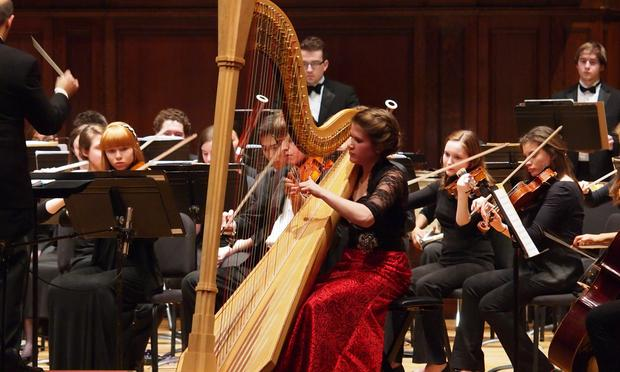 Harpist Rebekah Efthimiou during her solo performance this past spring at Oberlin's Finney Chapel.
