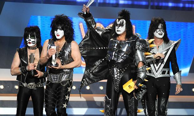 Musicians Eric Singer, Paul Stanley, Gene Simmons and Tommy Thayer of KISS speak at the Academy Of Country Music Awards in 2012