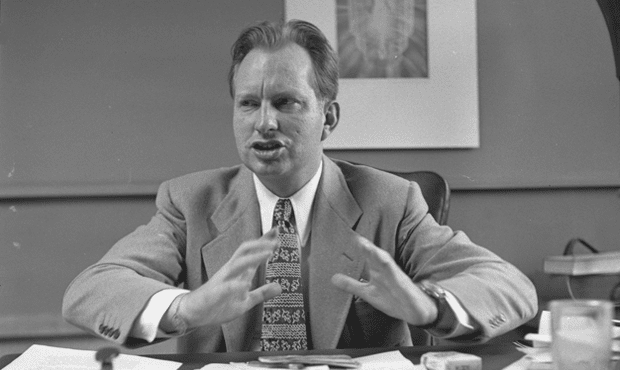 L. Ron Hubbard seated at desk, 1950