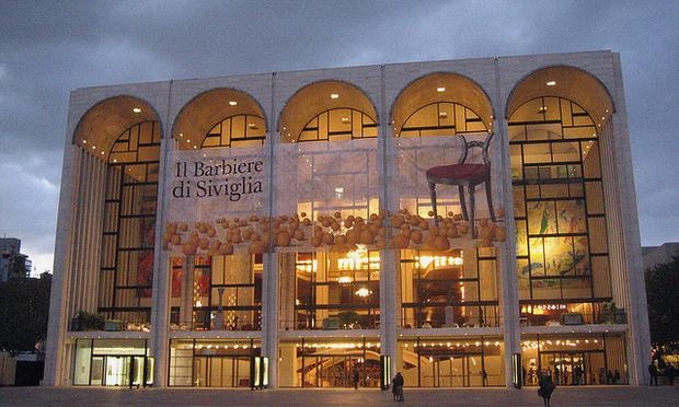 An ominous sky hangs over the Metropolitan Opera House