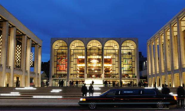 A limo arrives in front of the Metropolitan Opera House
