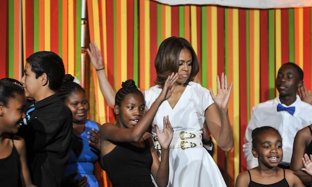 First Lady Michelle Obama performs with students during the White House Talent Show on May 20, 2014