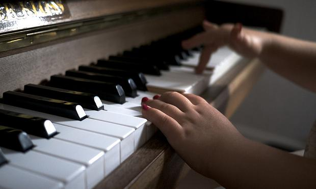 Learning to play the piano.