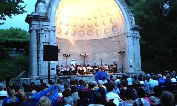 The Orpheus Chamber Orchestra resumes its concert on July 9, 2013, at the Naumburg Bandshell in Central Park following a rain shower.