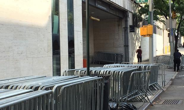Police barricades are stacked outside of the Metropolitan Opera's stage door entrance in advance of lockout deadline Sunday