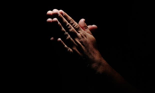 Praying hands.