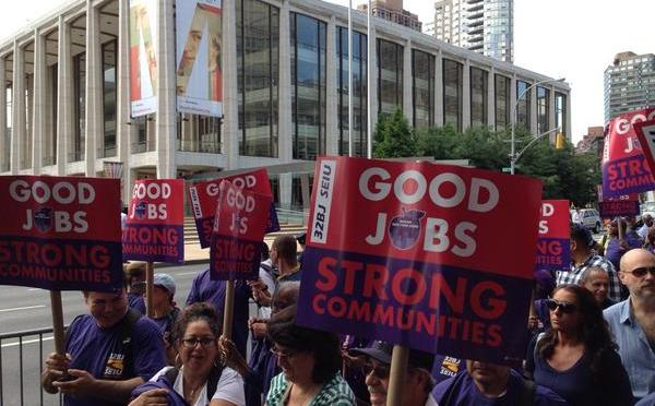 Members of the service workers' union 32BJ gathered outside Lincoln Center Thursday to protest proposed benefit cuts