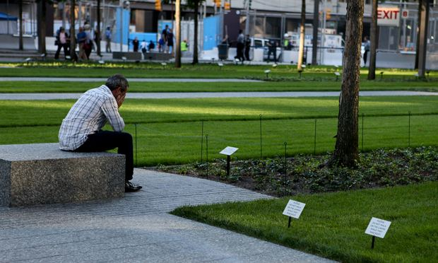 Visitors mourn at the 9/11 Memorial Plaza. World Trade Center
