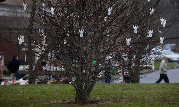 Angels hang from a tree outside of St. Rose Church in Newtown, Conn., after the deadly shooting at nearby Sandyhook Elementary School.