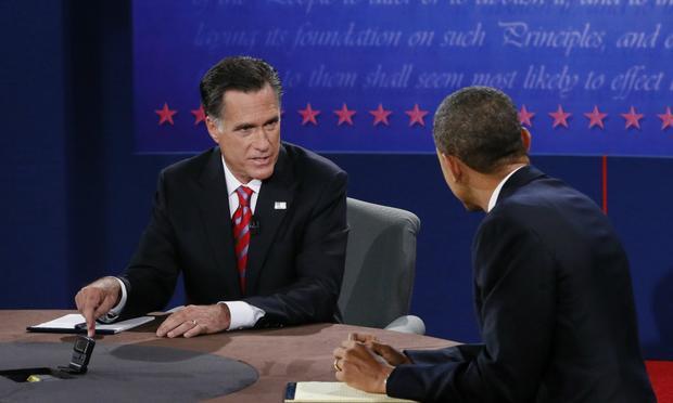 U.S. President Barack Obama (R) debates with Republican presidential candidate Mitt Romney.