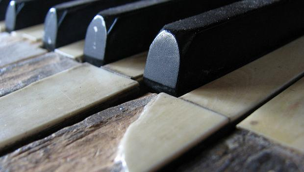 Old piano with chipped keys