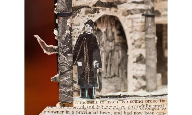 Book sculpture man standing outside