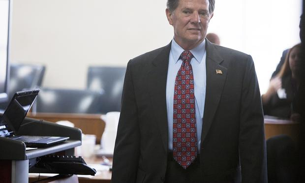 Former U.S. House Majority Leader Tom Delay stands in the 250th district court Travis county for jury selection in his corruption trial on October 26, 2010 in Austin, Texas. Delay was indicted five ye