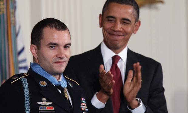 NOVEMBER 16: U.S. President Barack Obama (R() applauds Staff Sergeant Salvatore Giunta, U.S. Army, after awarding him the Medal of Honor for conspicuous gallantry in the East Room of the White House N