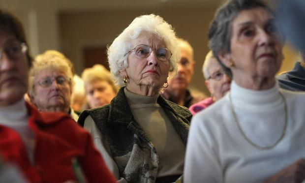 Seniors attend a 'Medicare Monday' seminar at the Holly Creek retirement community on December 6, 2010 in Centennial, Colorado. 80 people came to learn how federal health care reform will affect them.