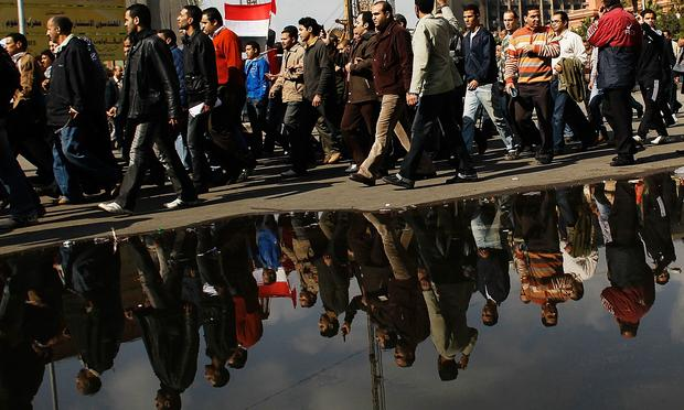 crowd of anti-government protesters in Tahrir Square on the morning of January 31, 2011 in central Cairo, Egypt