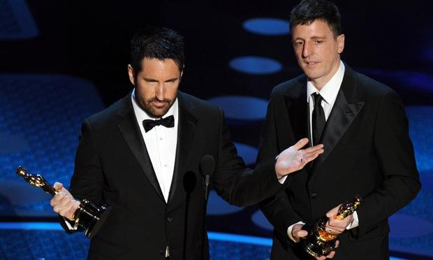 Composers Atticus Ross (R) and Trent Reznor, winners of the award for Best Original Score