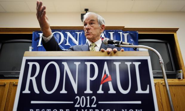 Republican presidential candidate Rep. Ron Paul (R-TX) speaks at the town hall in the Erickson Public Library during a campaign stop on December 8, 2011 in Boone, Iowa.