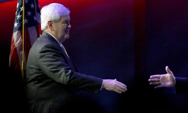 Republican presidential candidate, former Speaker of the House Newt Gingrich reaches to shake hands during a campaign stop at the Cathedral of Praise on January 15, 2012 in Charleston, South Carolina.