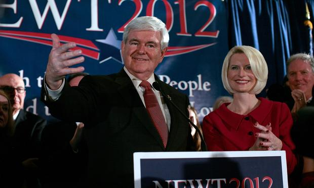 Republican presidential candidate, former Speaker of the House Newt Gingrich (L) speaks during a primary night rally with his wife Callista Gingrich January 21, 2012 in Columbia, South Carolina. With