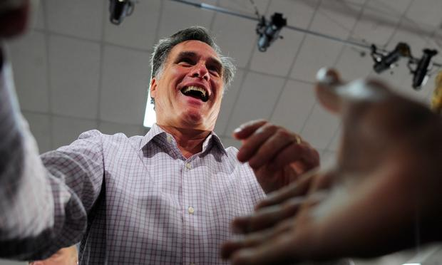 Republican presidential hopeful Mitt Romney greets supporters as he holds a campaign rally at Emma Lou Olson Civic Center in Pompano Beach, Florida, January 29, 2012.