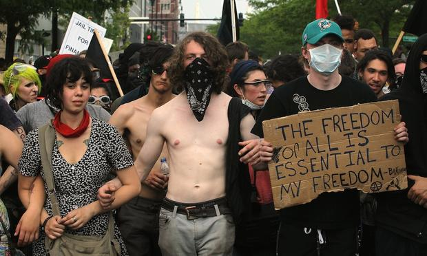 Demonstrators march through downtown streets protesting the NATO Summit on May 20, 2012 in Chicago, Illinois.