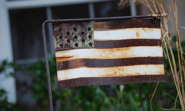 rusty American flag, poverty