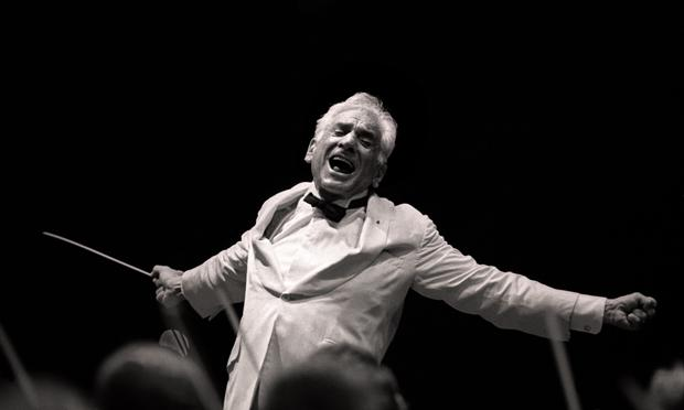 Leonard Bernstein conducts the New York Philharmonic in Central Park; August 4, 1986.