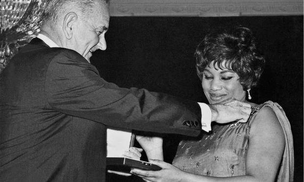 Opera singer Leontyne Price smiles while she is awarded the Presidential Medal of Freedom by President Lyndon Johnson