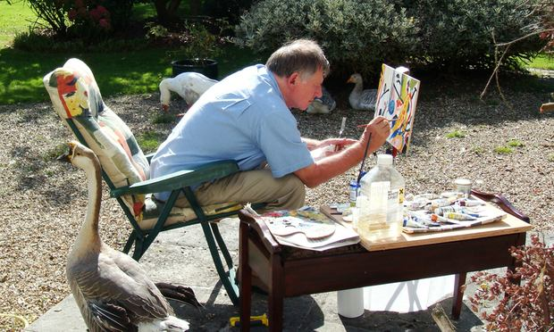 Architect and author Christopher Alexander, painting at his home in England