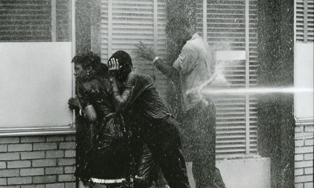 Photojournalist Charles Moore gets a comprehensive survey of his work at Steven Kasher Gallery. Above, the Birmingham Fire Department turns the high pressure hoses on civil rights protestors, 1963.
