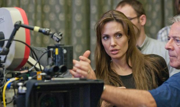 Director Angelina Jolie and DP Dean Semler discuss a shot while filming In the Land of Blood and Honey