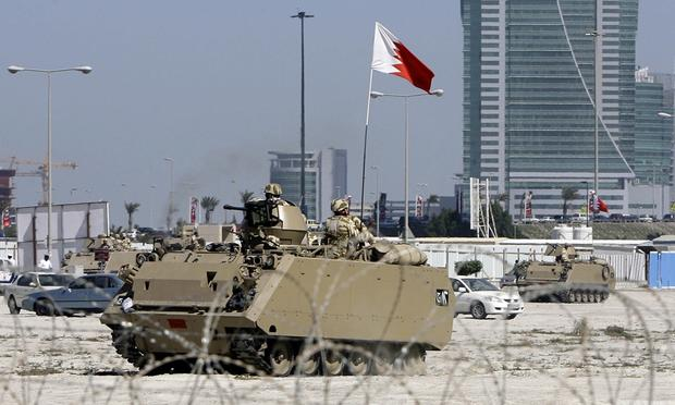 A Bahraini army APC pulls out of an area near Pearl Square in Manama on February 19, 2011.