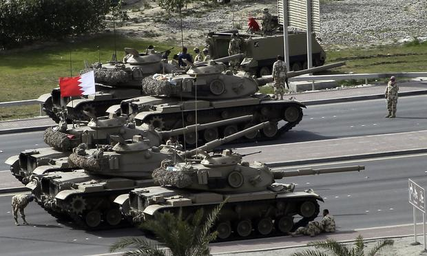 Bahraini army tanks take position near Pearl Square in Manama on February 17, 2011