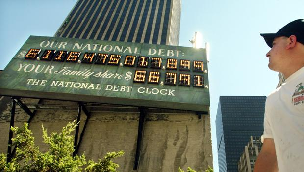 the National Debt Clock after it was restarted July 11, 2002 in New York City. The digital sign was turned off two years earlier when the federal government had a budget surplus.