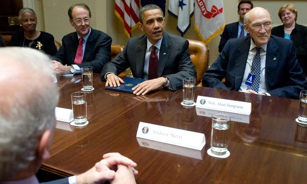 US President Barack Obama speaks alongside Erskine Bowles and Sen.Alan Simpson, co-chairs of the National Commission on Fiscal Responsibility and Reform